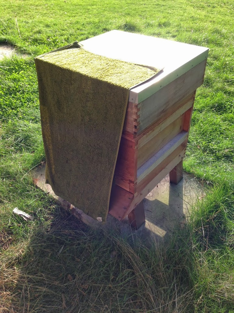 Towel placed on hive front